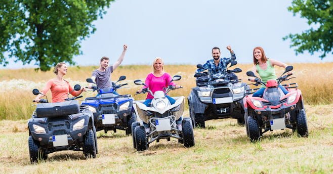group of people on their ATVs